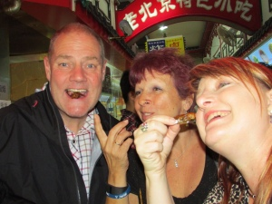 The three Musketeers about to eat scorpions – Jan centre, with Linda
