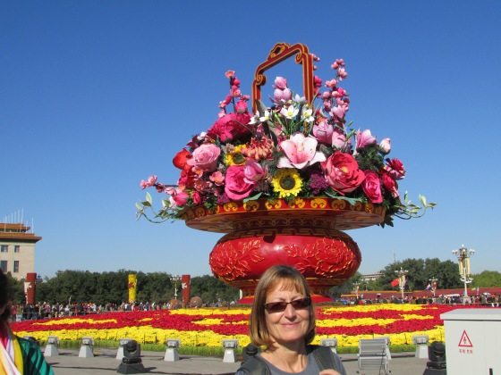 Sarah balancing a bouquet of flowers on her head in T Square Beijing when the sky was still blue..
