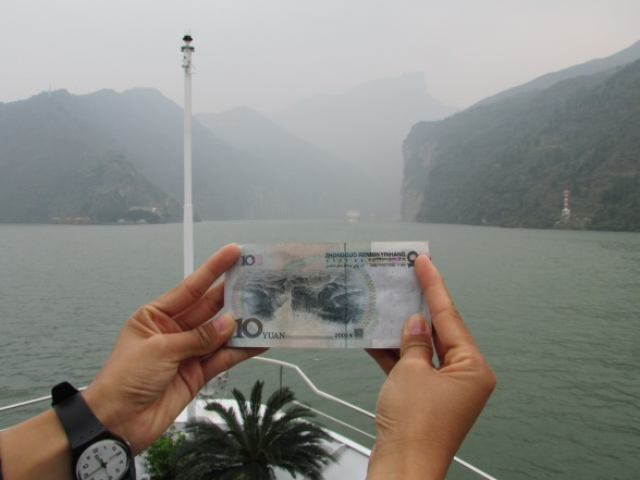 "Money talks – this £1 note equivalent depicts the entrance to the first of the ""Three Gorges"" (right)"