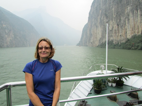 By gum it's nippy. Sarah standing at the front of the MS Victoria V – the limestone cliffs on either side are nearly 600ft high