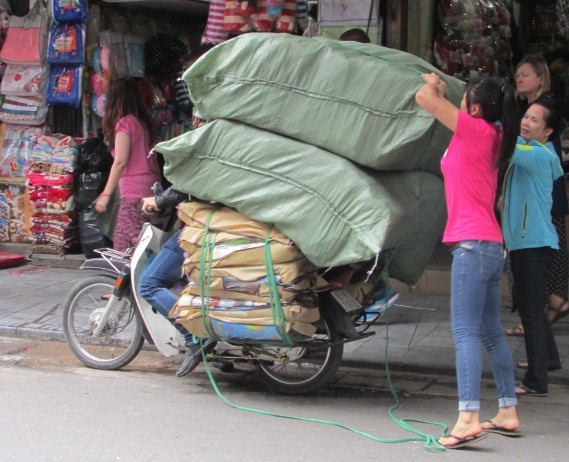 Most overloaded – five seconds after this shot was taken, the green bags fell off narrowly missing Sarah